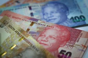 South African rand dips as dollar lifted by Fed minutes