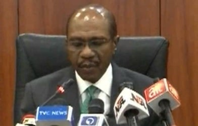 Nigeria's central bank holds benchmark lending rate at 12.5 pct